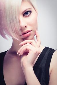 A beautiful and Glamorous girl with creative hair style. Toned and natural retouched.
