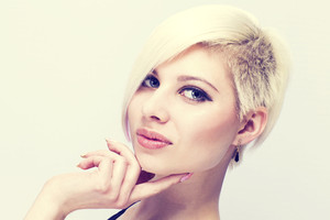 A beautiful and Glamorous girl with creative hair style. Warm toned.