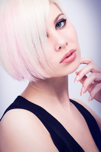 A beautiful and Glamorous young woman with creative hair style. Toned and natural retouched.