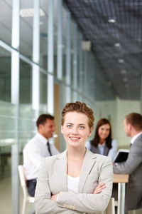 A beautiful businesswoman looking at camera in working environment