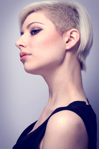 A beautiful glamorous young woman with creative hair style. Colored and natural retouched.