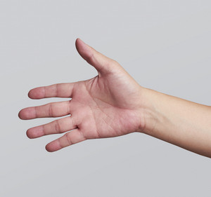 A hand is reaching out so it can shake hands.with clipping path