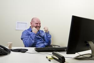 A office worker / businessman expresses success.