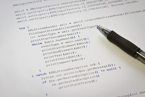A programmerg with Java computer code. Software / application program code. XML parser.