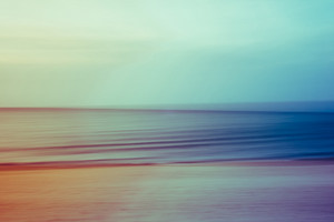 A vintage filtered abstract artistic ocean seascape with blurred panning motion