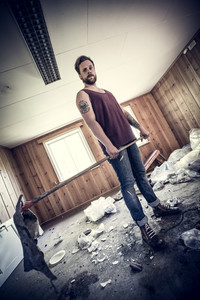 A young man, redneck / punk rocker cleaning up after party, Dirty and messy house..