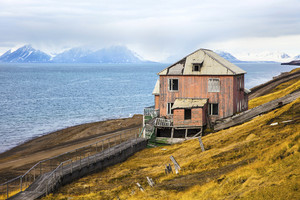 Abandoned house in the harsh arctic nature at summer