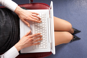 Above view of businesswoman typing on laptop in office
