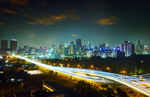 Abstract and car lighttrail  background, city skyline downtown background and highway interchanged nigh view .