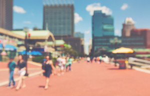 Abstract blurred people walking at the Inner harbor of Baltimore, Maryland
