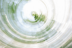 Abstract blurred spin in a spring forest background image created in camera