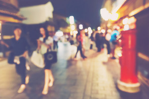 Abstract blurred street of women walking in the Gion district of Kyoto Japan