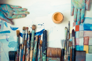 abstract brushes and paint in atelier