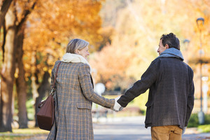 Active seniors on a walk in autumn town