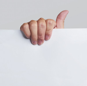 Advertising: Hand holding white empty paper . with clipping path