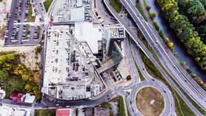Aerial view, building, car park and highway passing through town. Banska Bystrica, Slovakia.