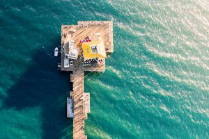 Aerial view of a coastal pier in the ocean