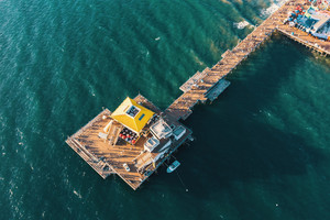 Aerial view of a pier in the pacific ocean on the California coast