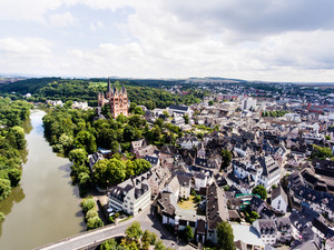 Aerial view of Dutch town with church, river, bridge and white historical buildings