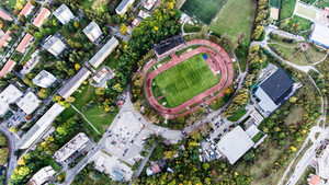 Aerial view of football stadium, apartment buildings and streets in town, Banska Bystrica, Slovakia.