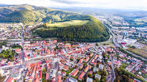 Aerial view of slovak town Banska Bystrica surrounded by green hills.