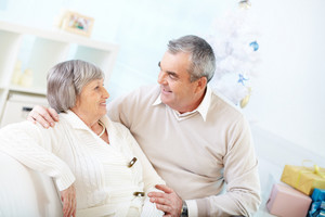 Affectionate seniors communicating at home