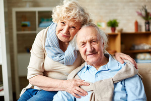 Affectionate seniors in casual-wear looking at camera