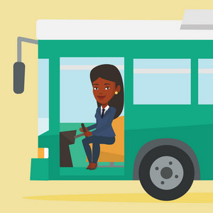 African-american bus driver sitting at steering wheel. Young female driver driving passenger bus. Female bus driver sitting in drivers seat in cab. Vector flat design illustration. Square layout.