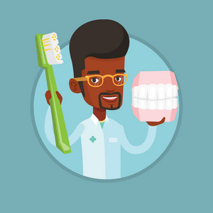 African-american dentist holding dental jaw model and a toothbrush in hands. Dentist showing dental jaw model and toothbrush. Vector flat design illustration in the circle isolated on background.