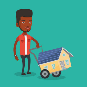 African-american man pushing a shopping trolley with a house. Young smiling man buying a house. Man using shopping trolley to transport a house. Vector flat design illustration. Square layout.