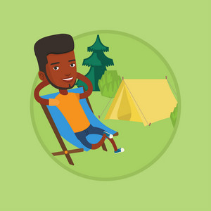 African-american man relaxing in camping. Man sitting in chair on the background of camping site. Man enjoying vacation in camping. Vector flat design illustration in the circle isolated on background