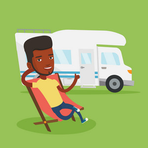 African-american man sitting in a folding chair and giving thumb up on the background of camper van. Young happy man enjoying his vacation in camper van. Vector flat design illustration. Square layout