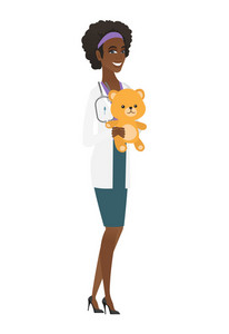 African-american pediatrician doctor holding a teddy bear. Pediatrician standing with a teddy bear. Young pediatrician in medical gown. Vector flat design illustration isolated on white background.