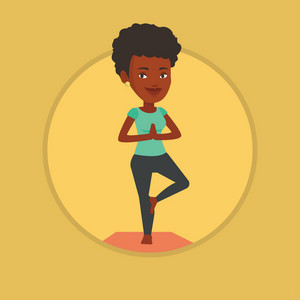 African-american sportswoman meditating in yoga tree position. Sportswoman standing in yoga tree pose. Woman doing yoga on the mat. Vector flat design illustration in the circle isolated on background