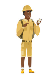 African-american traveler holding mobile phone and pointing at it. Full length of traveler with mobile phone. Traveler using mobile phone. Vector flat design illustration isolated on white background.