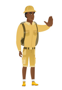 African-american traveler showing stop hand gesture. Full length of traveler doing stop gesture. Serious traveler with a stop gesture. Vector flat design illustration isolated on white background.