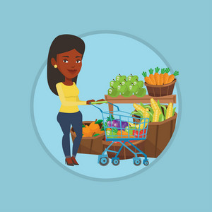 African-american woman pushing a supermarket cart with some healthy products in it. Customer shopping at supermarket with cart. Vector flat design illustration in the circle isolated on background.