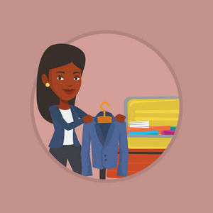 African-american woman putting a jacket into a suitcase. Woman packing clothes in an opened suitcase. Woman preparing for vacation. Vector flat design illustration in the circle isolated on background