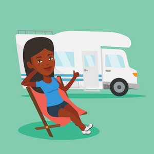 African-american woman sitting in a folding chair and giving thumb up on the background of camper van. Young woman enjoying her vacation in camper van. Vector flat design illustration. Square layout.