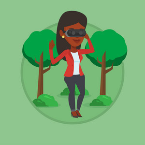 African gamer wearing virtual reality headset in the park. Woman using virtual reality glasses and playing videogame in the park. Vector flat design illustration in the circle isolated on background