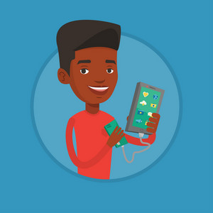 African man recharging his smartphone with mobile phone portable battery. Young man holding a mobile phone and battery power bank. Vector flat design illustration in the circle isolated on background.