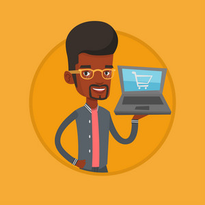 African man using laptop for online shopping. Man holding laptop with shopping trolley on a screen. Man doing online shopping. Vector flat design illustration in the circle isolated on background.