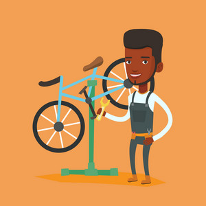African man working in bike workshop. Technician fixing bicycle in repair shop. Bicycle mechanic repairing bicycle. Man installing spare part bike. Vector flat design illustration. Square layout.