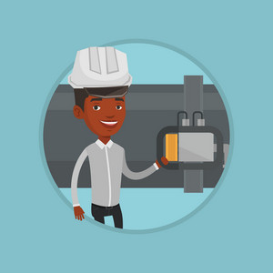 African operator of oil refinery plant checking detector on pipeline. Worker in hard hat standing on the background of pipeline. Vector flat design illustration in the circle isolated on background.