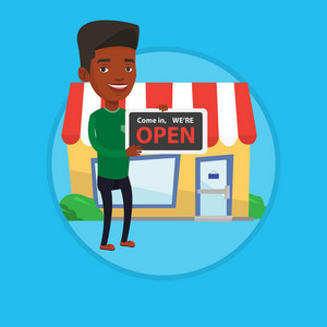 African shop owner holding open signboard. Cheerful shop owner standing in front of small store. Man inviting to come in her shop. Vector flat design illustration in the circle isolated on background.