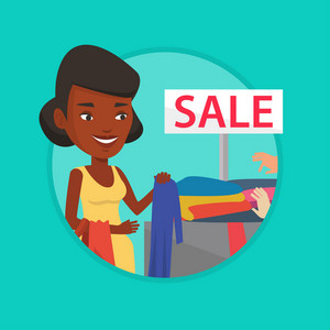 African woman choosing clothes in shop on sale. Woman buying clothes at store on sale. Woman shopping in clothes shop on sale. Vector flat design illustration in the circle isolated on background.