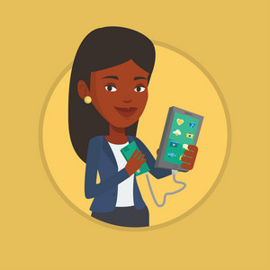 African woman recharging her smartphone with mobile phone portable battery. Woman holding a mobile phone and battery power bank. Vector flat design illustration in the circle isolated on background.