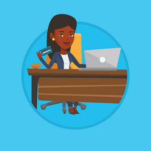 African woman sitting at the table with laptop and holding credit card in hand. Woman using laptop for online shopping at home. Vector flat design illustration in the circle isolated on background.