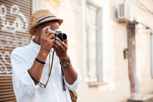 Afro american man making photo. on the street