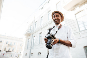 Afro photographer on the street. photo from below